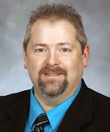 Portrait of Mark Oman