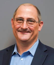 Portrait of Mike Kenealy