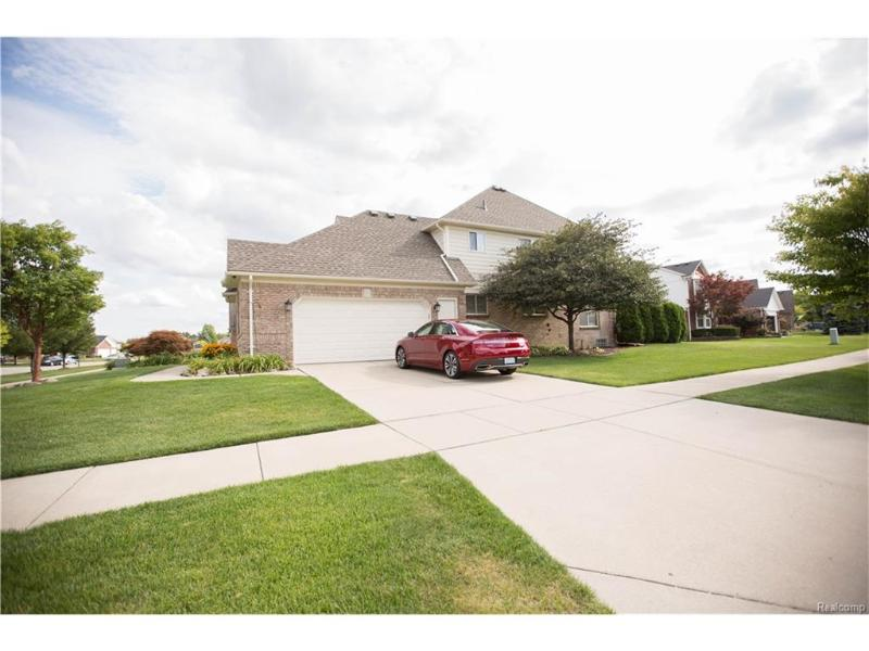 46707 Riverwoods Dr,  Macomb, MI 48044 by Real Estate One $334,900