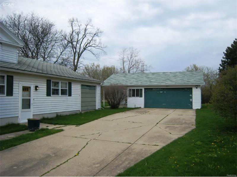 6396 W Court St,  Flint, MI 48532 by American Associates Inc $75,000