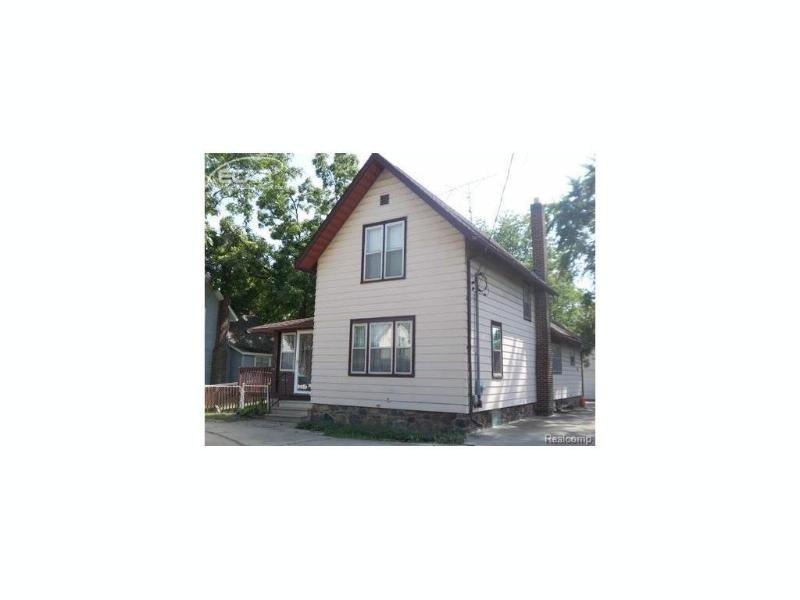 1415 W Main St,  Owosso, MI 48867 by The Home Office Realty Llc $65,000