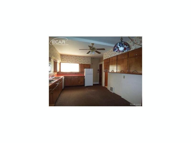 1415 W Main St,  Owosso, MI 48867 by The Home Office Realty Llc $63,000