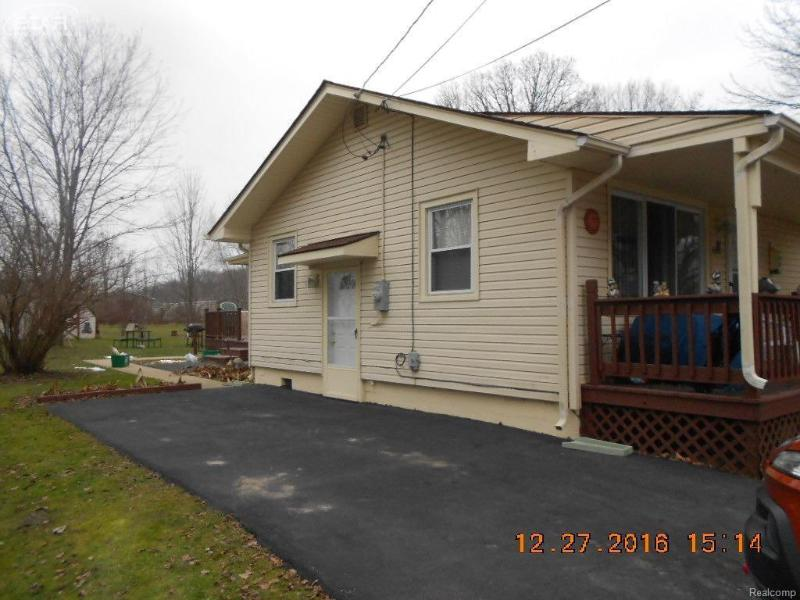 3300  Ellis Park Dr,  Burton, MI 48519 by Forest Homes And Land Llc $49,900