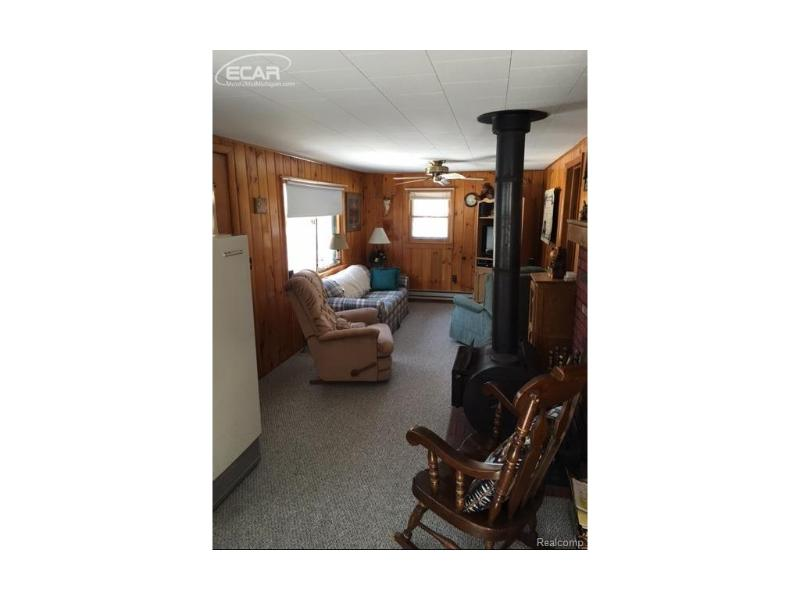 4484  Visco,  Comins, MI 48619 by Forest Homes And Land Llc $32,000