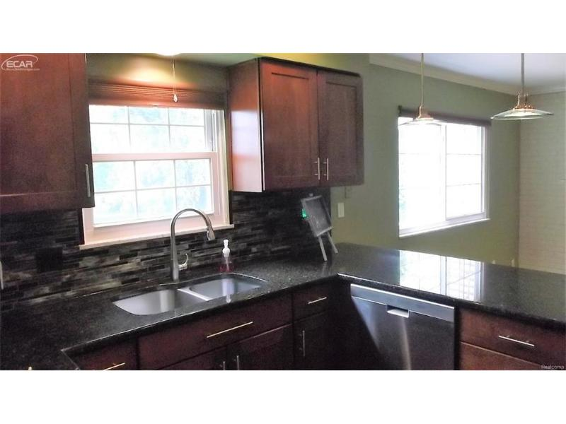 9024  Creekview Ct,  Grand Blanc, MI 48439 by Real Living Tremaine Real Estate.com $180,000