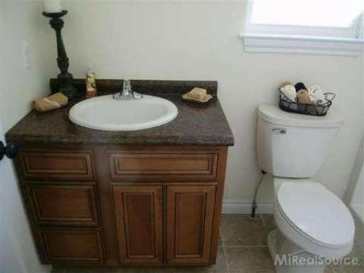 1007 Cottage Wood Ln.,  Algonac, MI 48001 by Sine & Monaghan Realtors Real Living $173,900