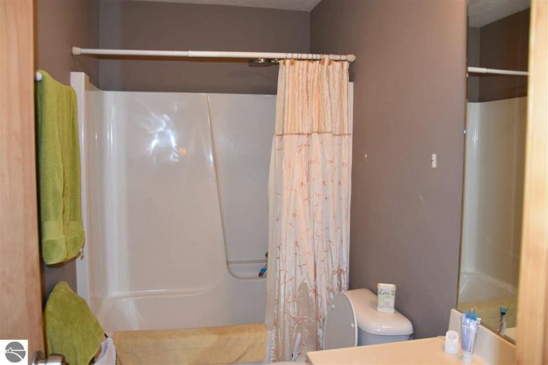 6036 NE Smith Road,  Rapid City, MI 49676 by Coldwell Banker Schmidt-Kalkas $161,500
