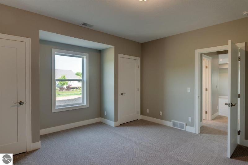1378 Alexander Drive,  Traverse City, MI 49686 by Coldwell Banker Schmidt-402 $384,500