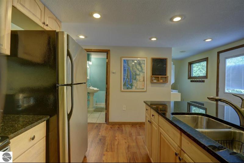 8283 Aarwood Trail Rapid City, MI 49676 by Coldwell Banker Schmidt-402 $375,000
