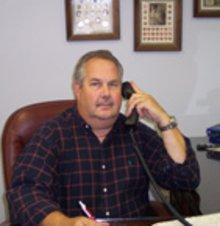Portrait of Dennis Manuel