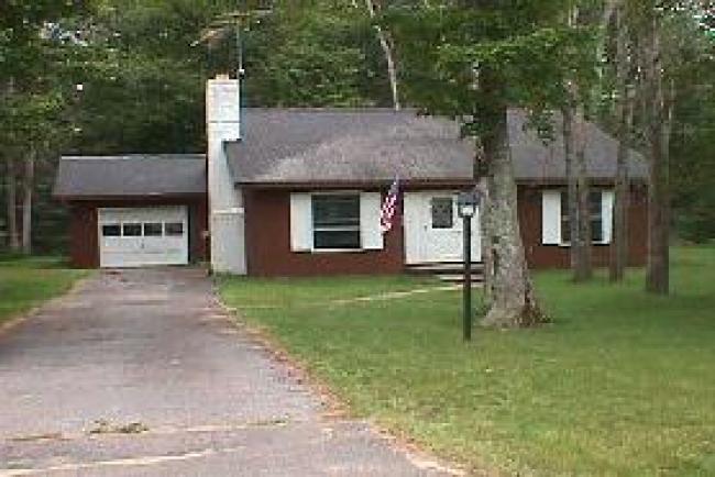 7664 Woodlea Oscoda, MI 48750 by Real Estate One $57,900